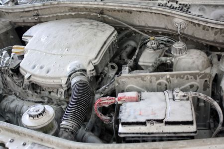 Motor cleanind with active foam to carwash. Stock Photo