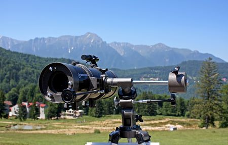 disposed: Telescope disposed to see the beauty of Carpathian mountains Stock Photo