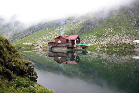 Balea lake from Carpathian mountains in Romania photo
