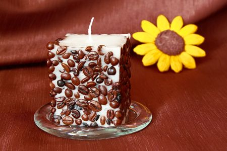 Candle decorated with coffee beans and yellow flower Stock Photo - 5954498