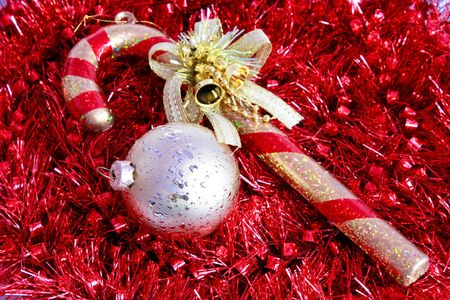 Christmas ball with walking stick wrapped in garland Stock Photo - 6080724