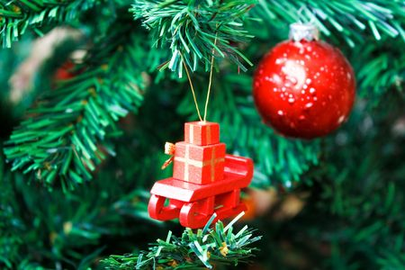 Sledge with gifts hanged on xmas tree Stock Photo - 6115855