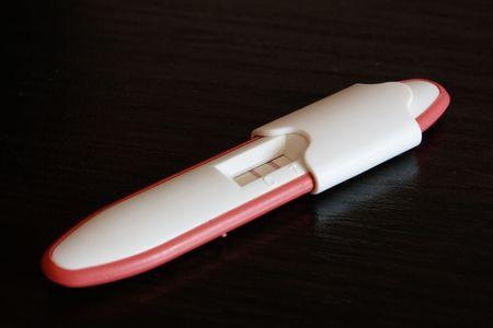 Closeup scene with pregnancy positive test photo