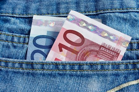 Euro notes in the back pocket of blue jeans