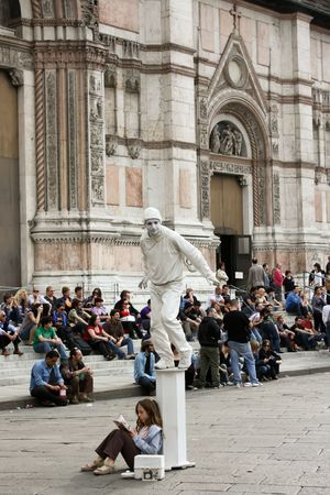 Bologna 05.01.2010 - Mime on a white column in Bologna Editorial