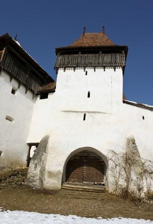 Viscri, Romania - March 05, 2011 - Frontal view of medieval church from Viscri village