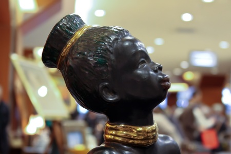 Cluj-NApoca, Romania - April 16, 2011 - Traditional african statuette of young woman Stock Photo - 9433435