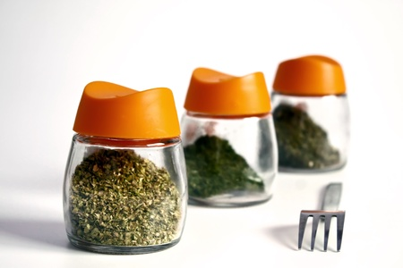 Spice jars on isolated white background