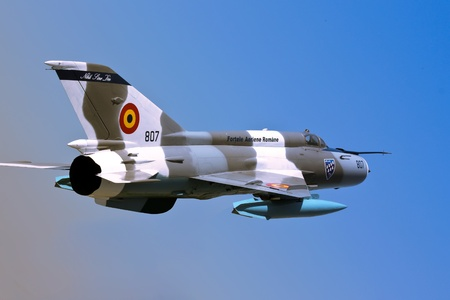 Luna, Romania - July 19, 2011 - MiG 21 - Romanian fighter aircraft isolated over blue sky