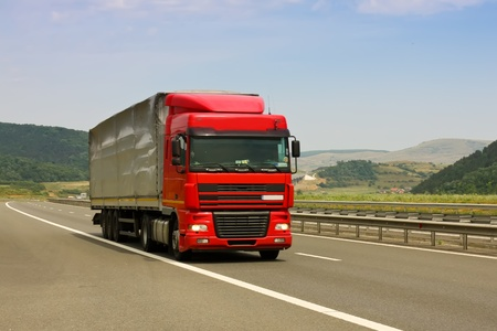 Gilau, Romania - July 20, 2011 - Truck on asphalt road in a summer day Editorial