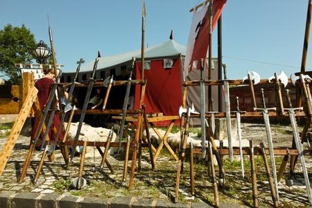 strategically: Brasov, Romania - August 06, 2011 - Arms at medieval festival in Brasov