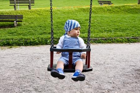 Child on teeter in park Stock Photo - 10296031