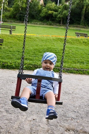 Adorable child on teeter in a summer day Stock Photo - 10296027