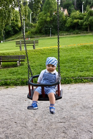 The small child shakes on a teeter Stock Photo - 10296032
