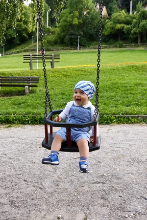 Little boy riding in teeter on playground Stock Photo - 10296030