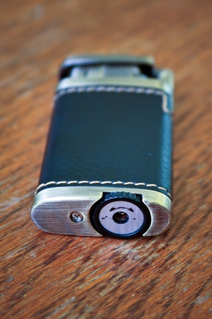 Old cigarette lighter dressed in leather on the table Stock Photo - 11075085