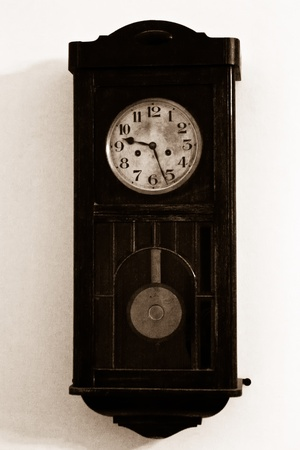Very old wooden clock on the wall photo