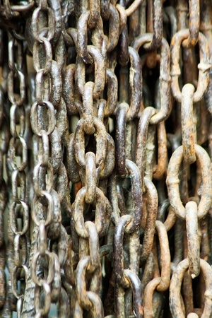 Closeup picture of strong chains what is beginning rust. Stock Photo - 11075092
