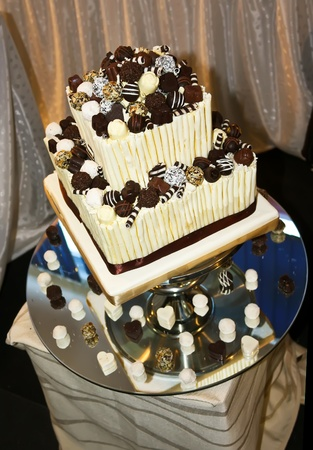 Beautiful cake ornated with praline chocolates photo