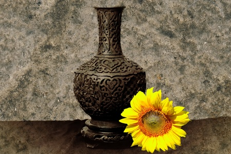 Shot with traditional vase and sun flower Stock Photo