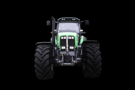 Frontal scene with a new tractor isolated on black background   Stock Photo