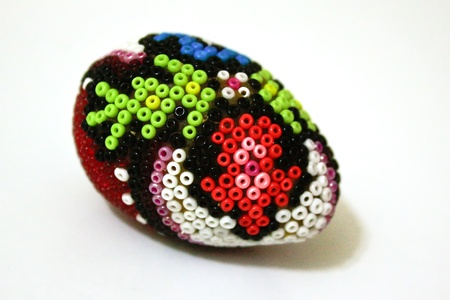 Traditional hand made Easter egg with beadwork on top Stock Photo - 11763942