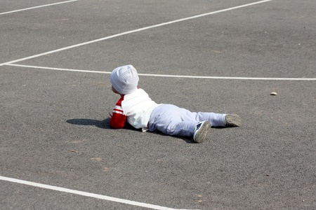 A little child who fell on the asphalt Stock Photo - 12803359