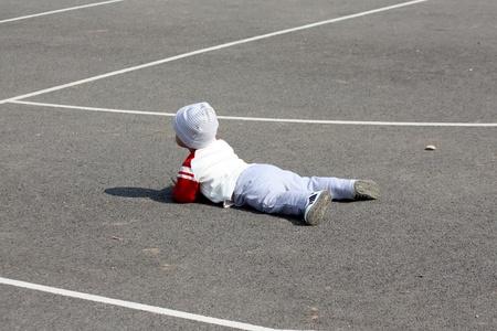 A little child who fell on the asphalt Stock Photo - 12803359