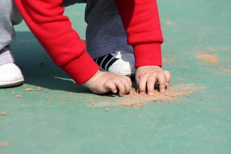 A little child who is playing with sand Stock Photo - 12803352