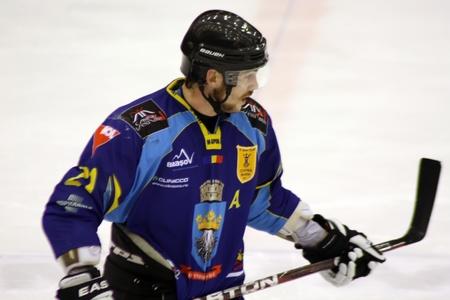 Brasov, Romania - 28.03.2012 - Hockey player of Brasov team on ice Stock Photo - 12877474
