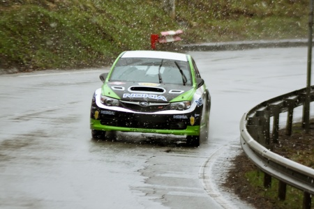 Brasov, Romania - 30.03.2012 - Green car durring the competition at Brasov rally Stock Photo - 12925793