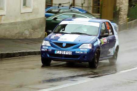 Brasov, Romania - 30.03.2012 - Blue Dacia Logan durring the competition at Brasov rally Stock Photo - 12925784
