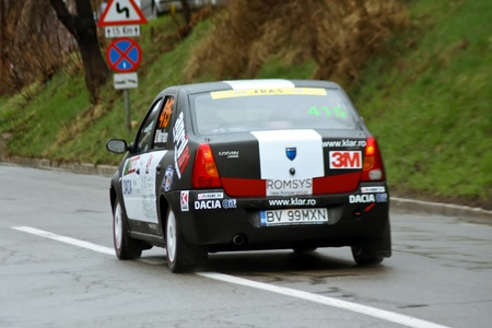 Brasov, Romania - 30.03.2012 - Back side of Dacia Logan in rally contest Stock Photo - 12925774