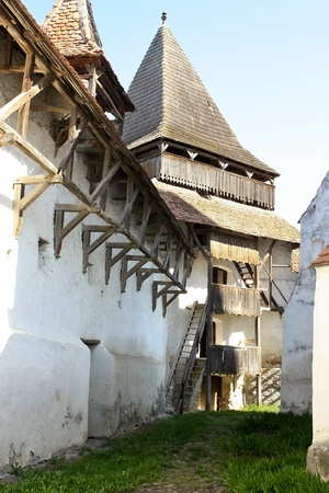Homorod, Romania - 28.04.2012 - Defensive walls with tower of fortified church from Homorod