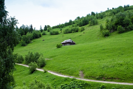 Wood house on the hill from Romanian village photo
