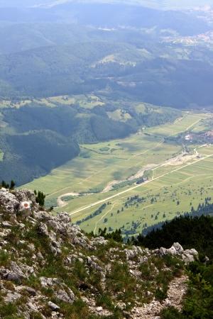 Rural road seen by Piatra Craiului ridge photo