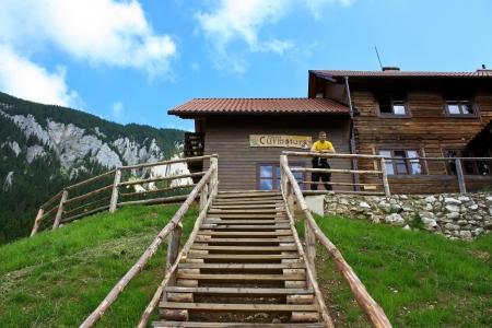 Curmatura, Romania - 30.06.2012 - Frontal view of Curmatura chelet from Piatra Craiului Stock Photo - 14339784