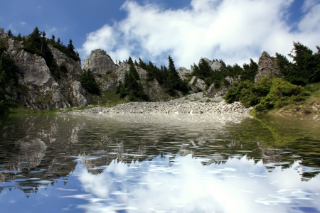 Nature landscape with mountain peak what is reflected on water surface Stock Photo - 14437949