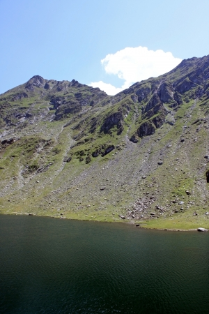 Glacial lake at high altitude in Carphatian mountains photo