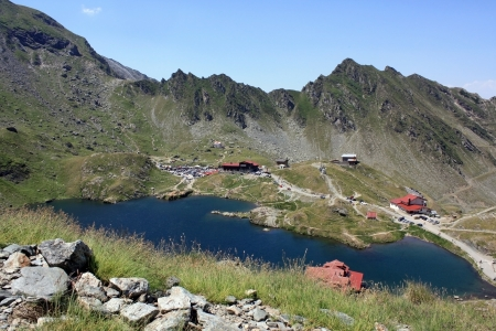 Balea glacial lake and road Transfagarasan, Romania Stock Photo - 14540849