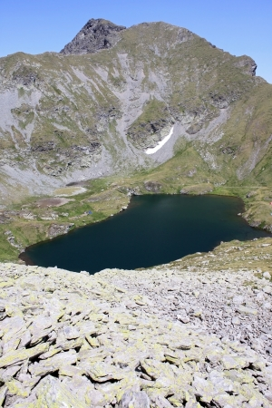 The alpine Goat Lake is situated in the southern Fagaras mountains, in Sibiu county, Romania  photo