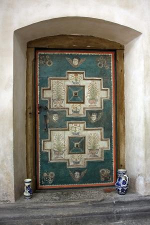 secular: Carta, Romania - 21.07.2012 - Secular door in the cistercian church from Carta, Romania