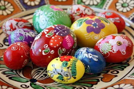 Easter eggs hand painted with traditional motifs on decorated plate