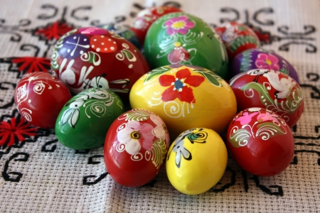 Easter eggs hand painted with traditional motifs over tablecloth Stock Photo - 14989701