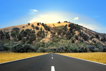 Day scene of clean highway over great hill Stock Photo - 15165900