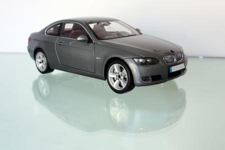 bonnet: Miniature model of a car over glass background