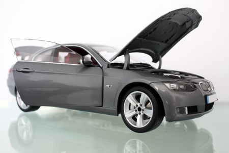 Miniature model of a car with hood open Stock Photo