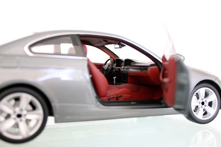 Miniature model of a car with right door open Stock Photo