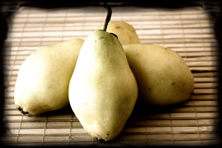 Sweet pears still life with vintage look and dark border Stock Photo - 16177902