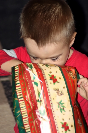 Happy child receive the gift of Christmas day photo